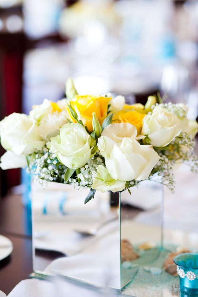 wedding mirror flower arrangement.