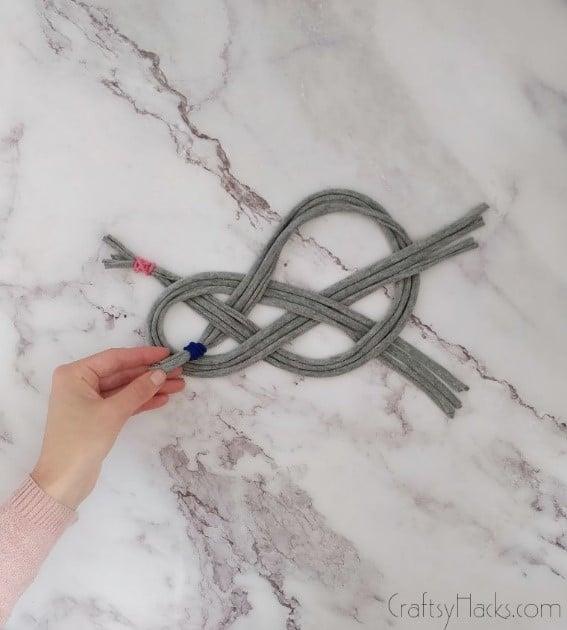 pulling blue elastic through bottom loop