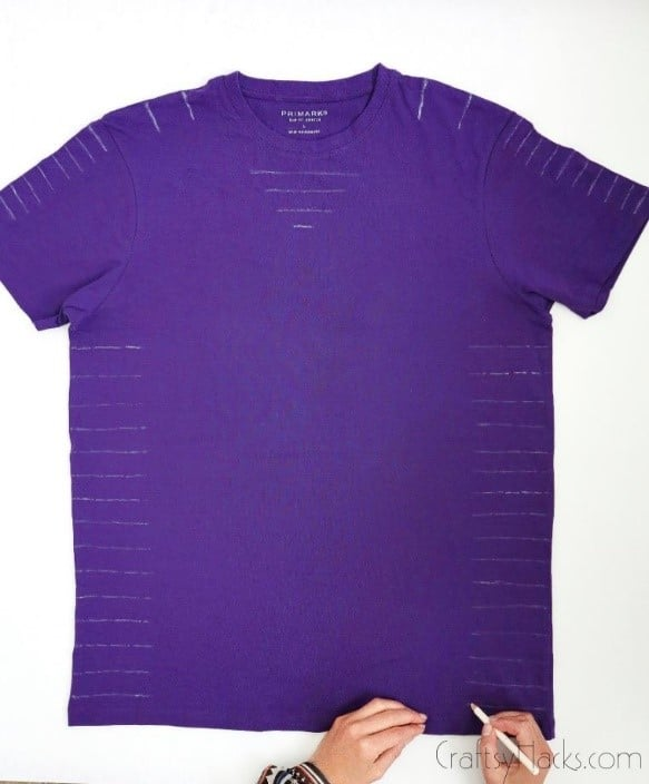 purple shirt with white pencil markings