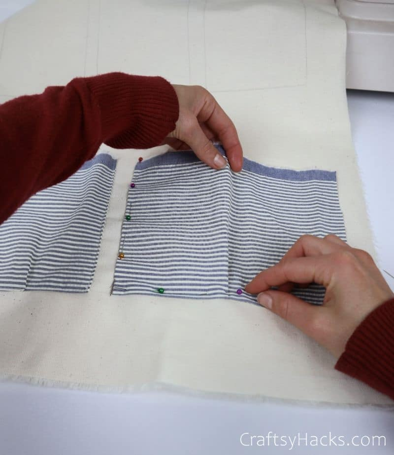pinning fabric down