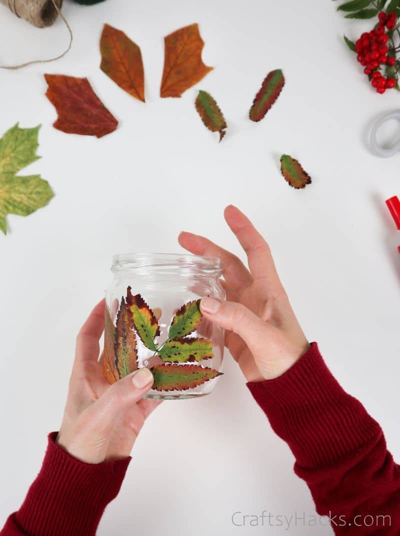 attaching leaves to candle holder
