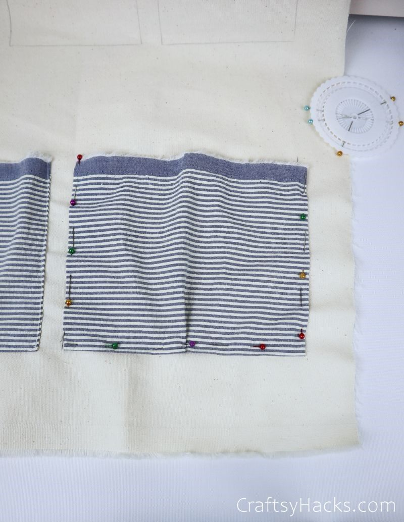 fabric rectangle with pins all around