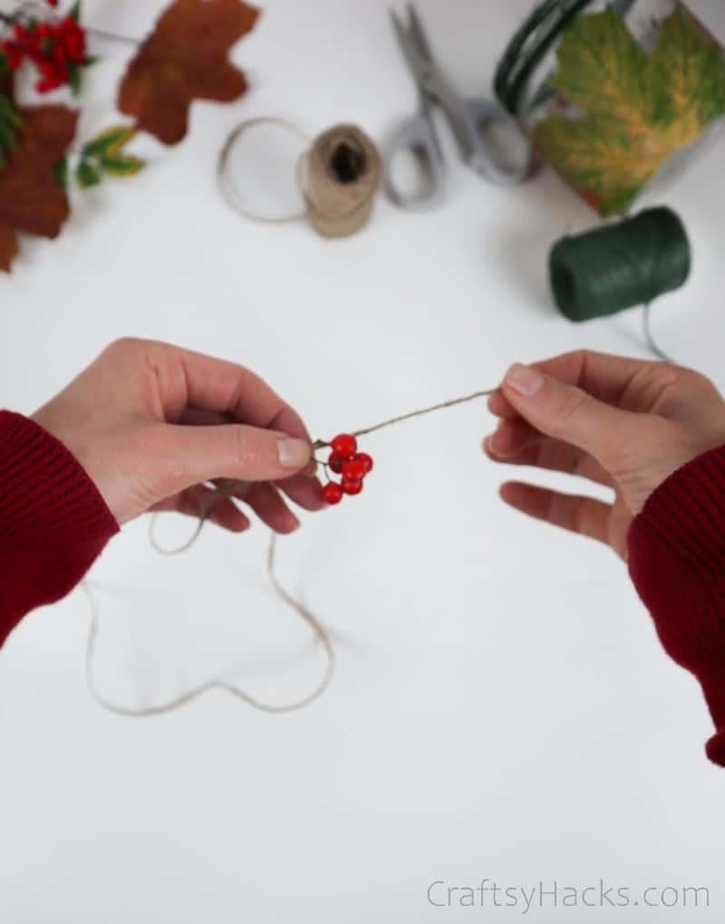 wrapping red berries in twine