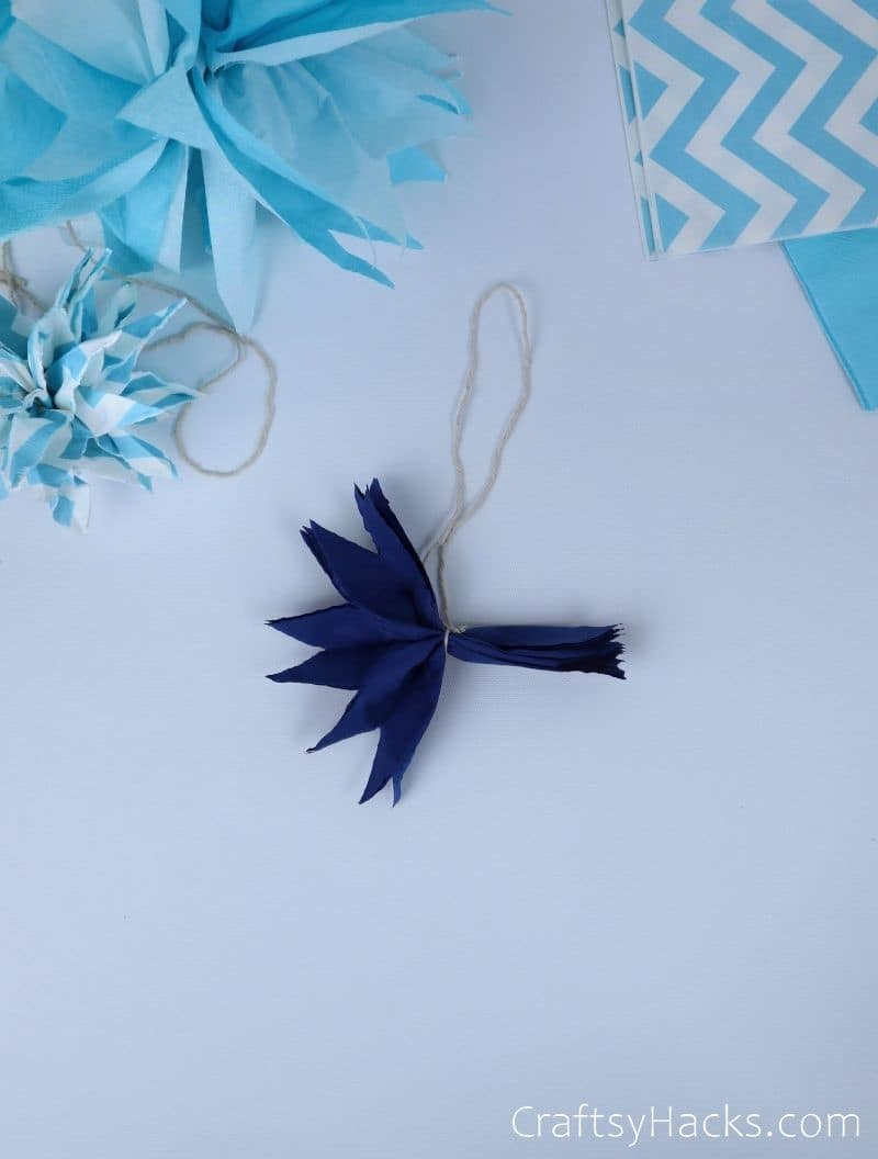 pom pom with cut outs on one side