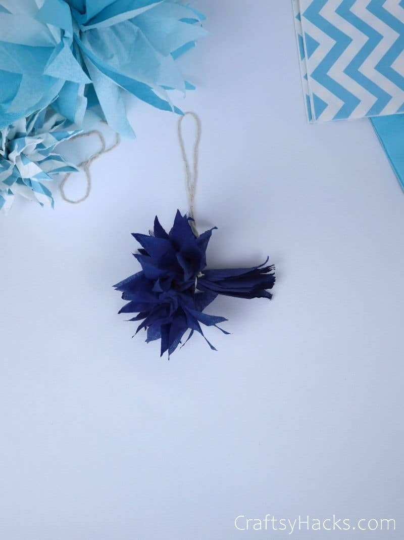 fanned out tissue paper pom poms