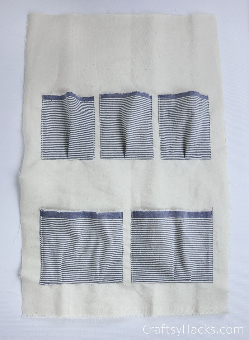 five pockets sewed onto fabric