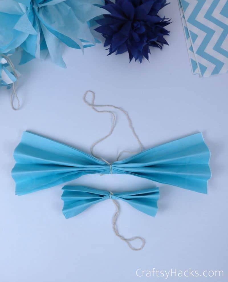 light blue tissue with string tied around