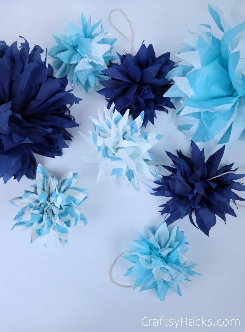 different coloured pom poms layed out