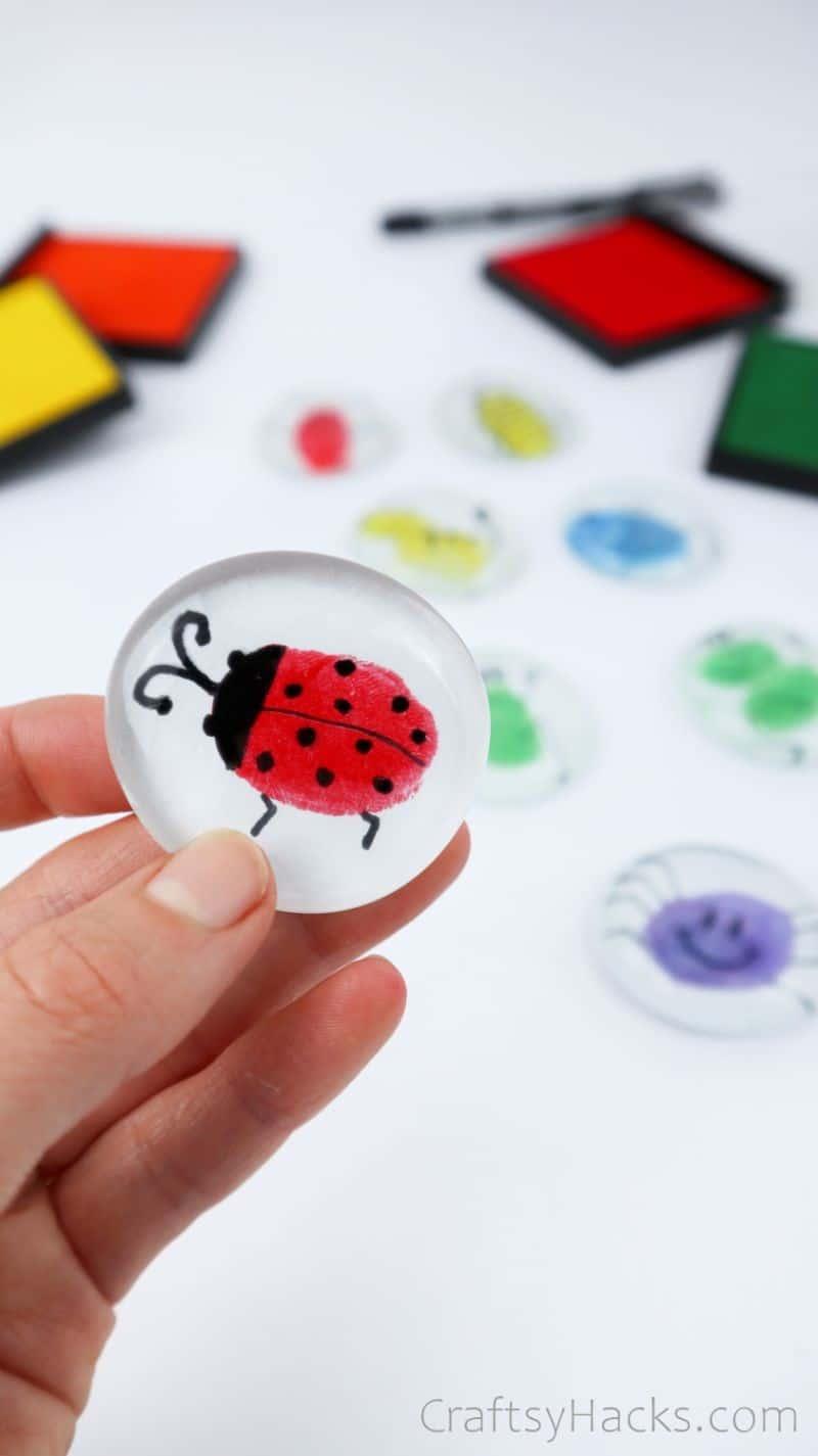 holding ladybug glass magnet