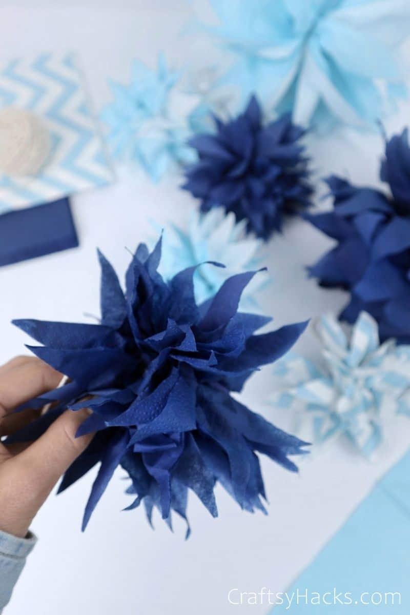 close up of blue pom pom