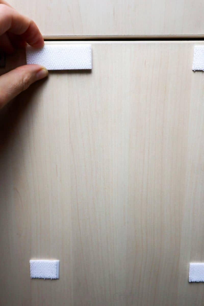 adding velcro strips to cabinet