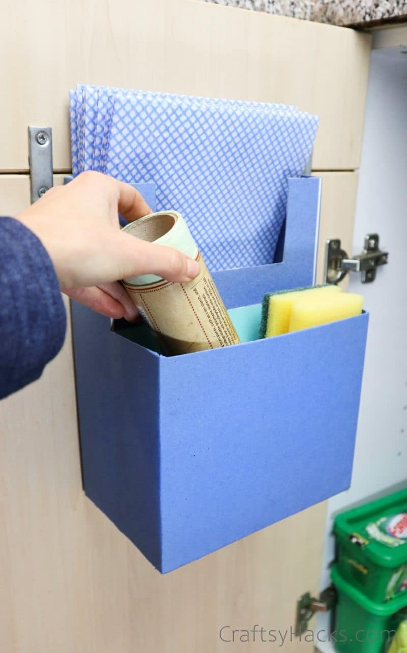 adding cleaning products to organizer