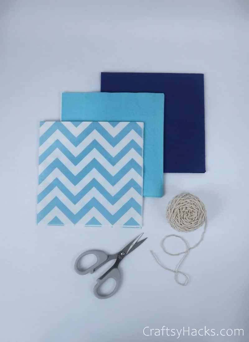 tissue paper, scissors and string