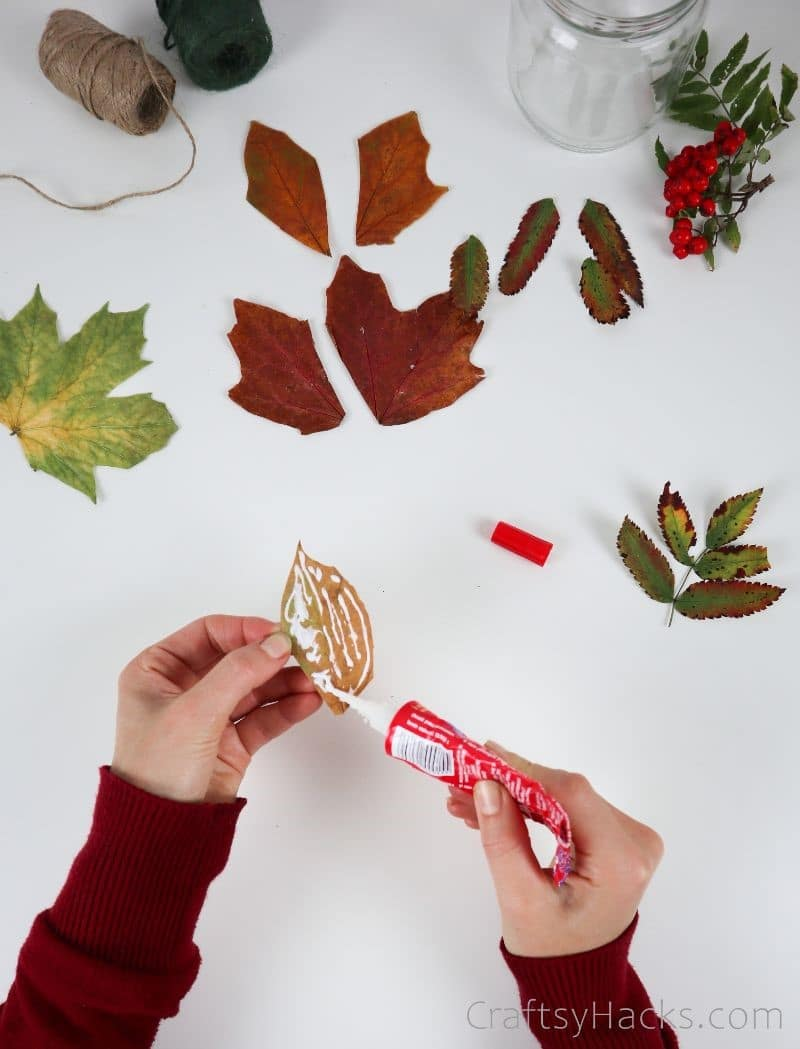 adding glue to leaves