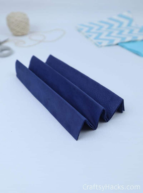 fan-folded blue tissue paper