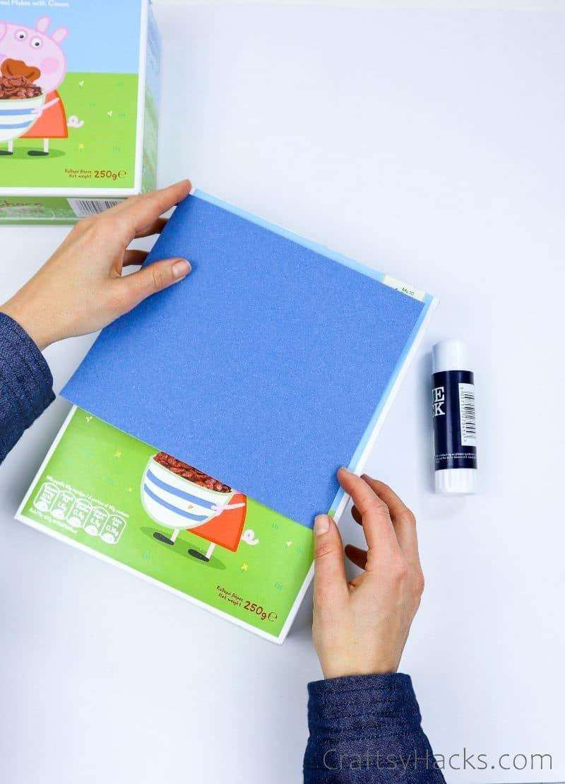 adding construction paper to organizer
