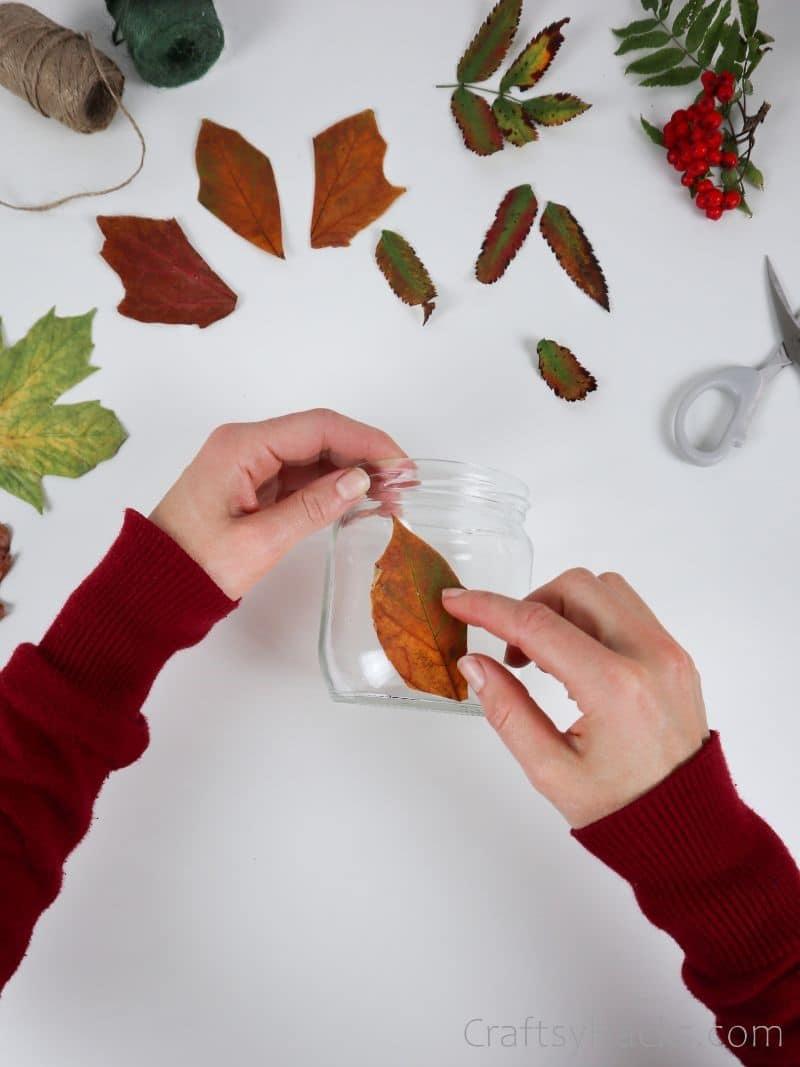 glueing leaf to jar