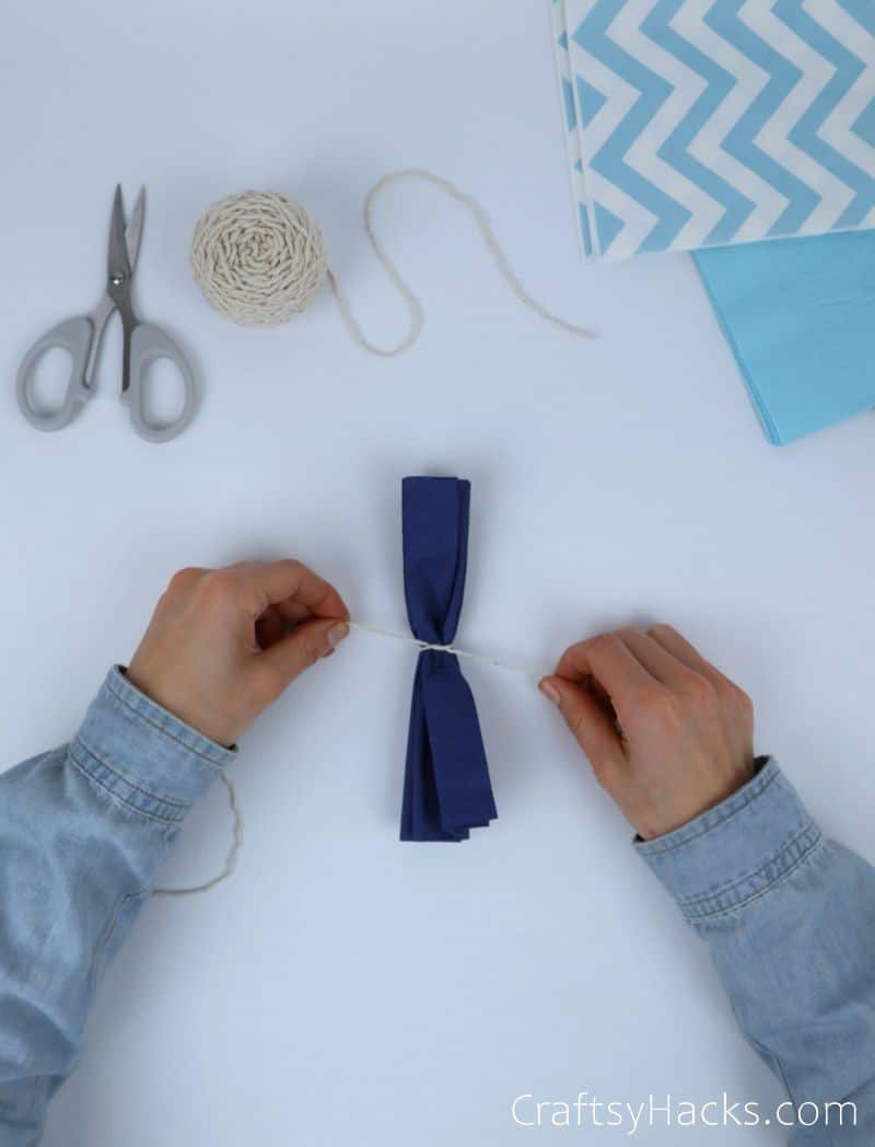 tying string around tissue paper