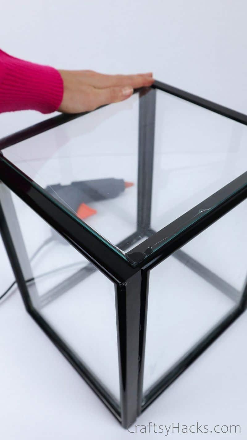 attaching glass to bottom of lantern