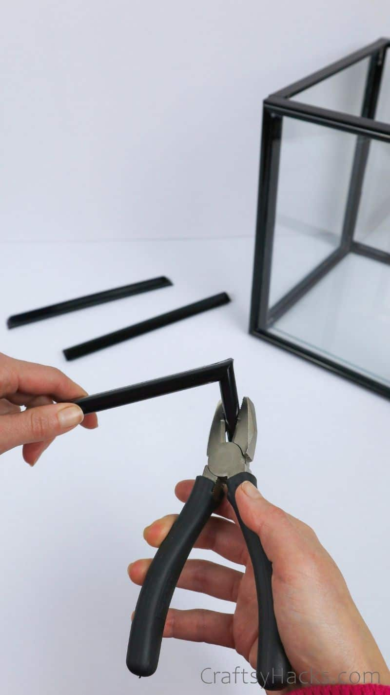 taking apart remaining frame with pliers