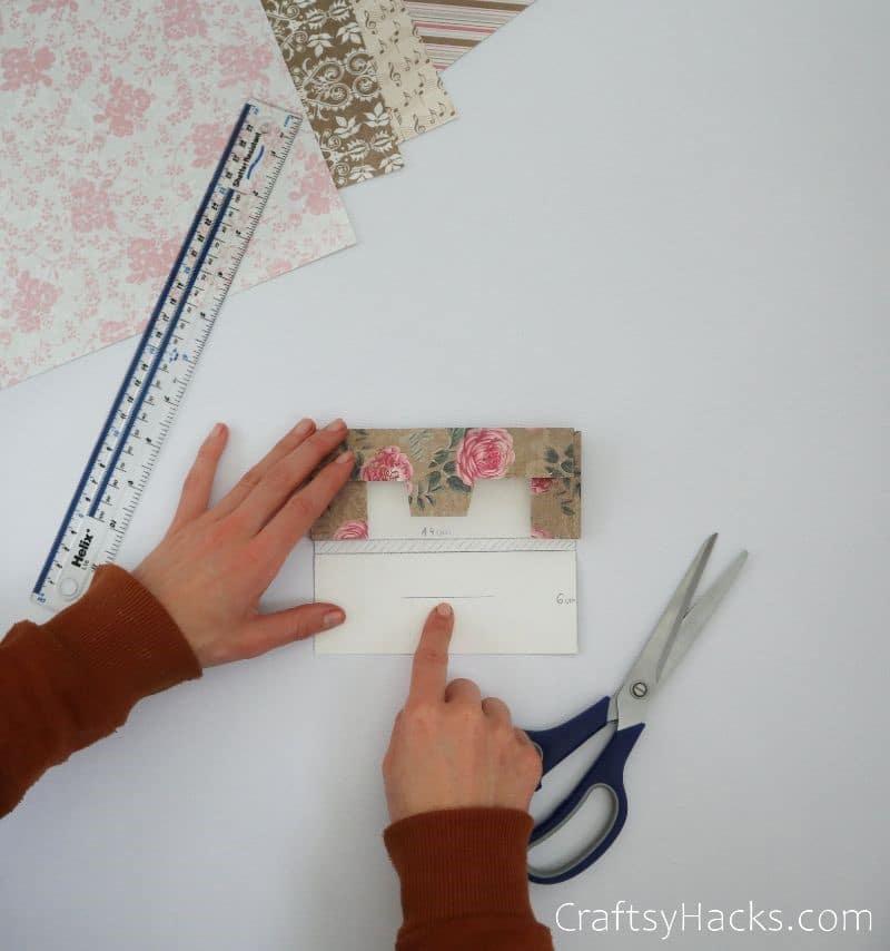 holding folded paper envelope