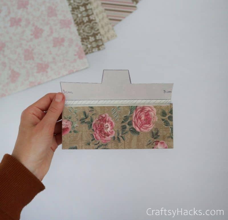holding complete folded envelope
