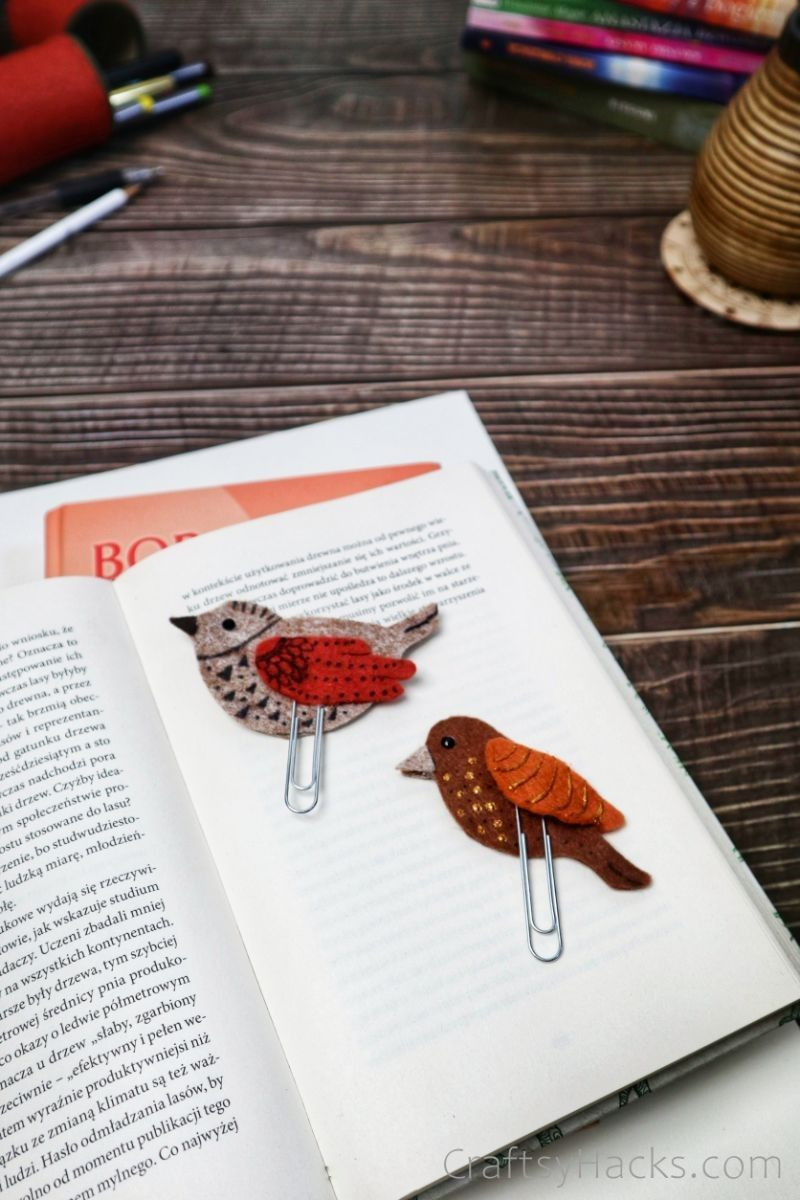two bird bookmarks in open book