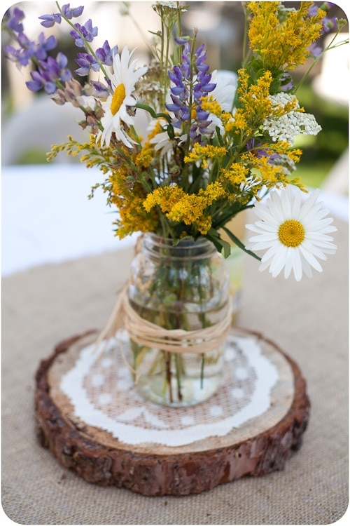 Mason Jar with purple and yellow flowers