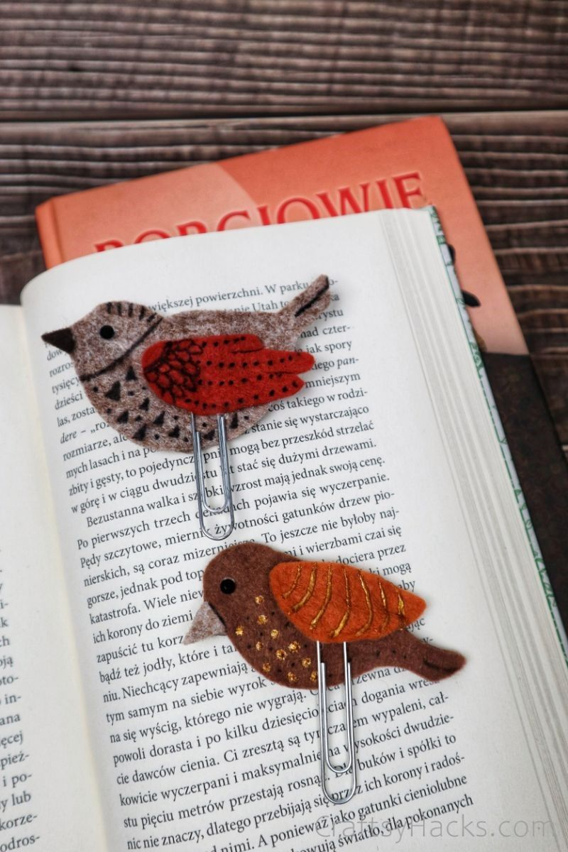 two handmade bookmarks in open book