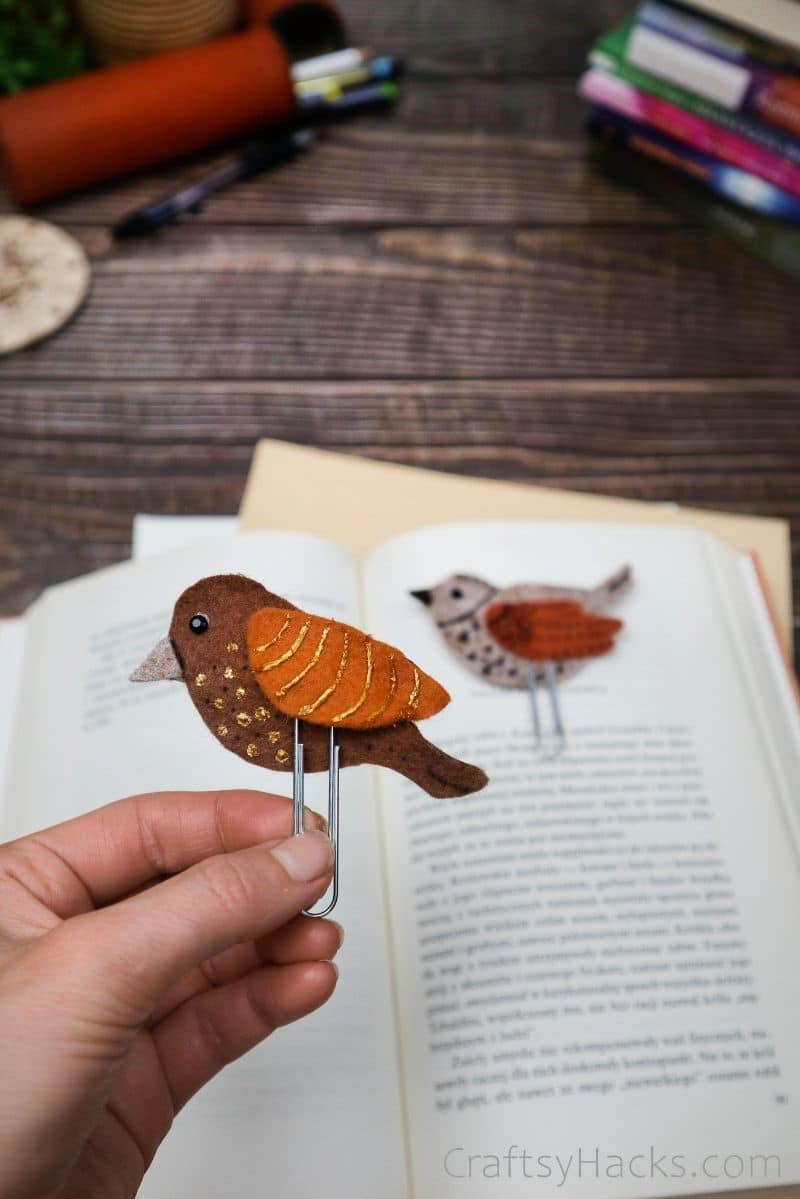 holding bird bookmark