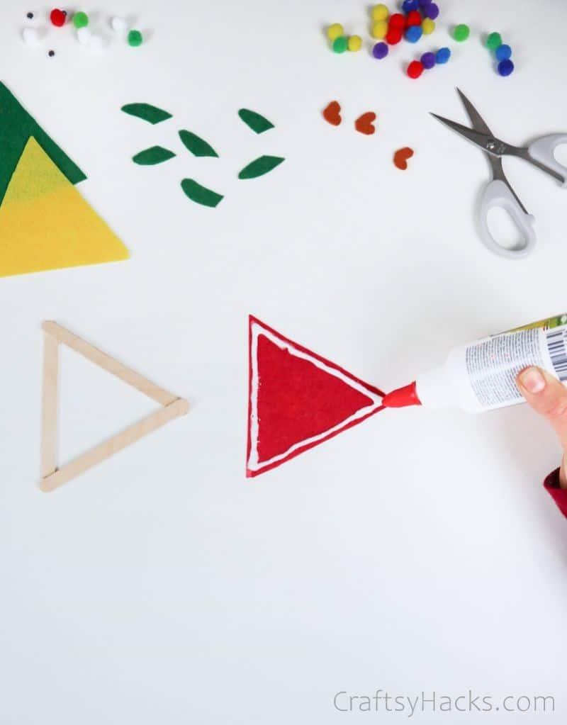 glueing cut felt triangle
