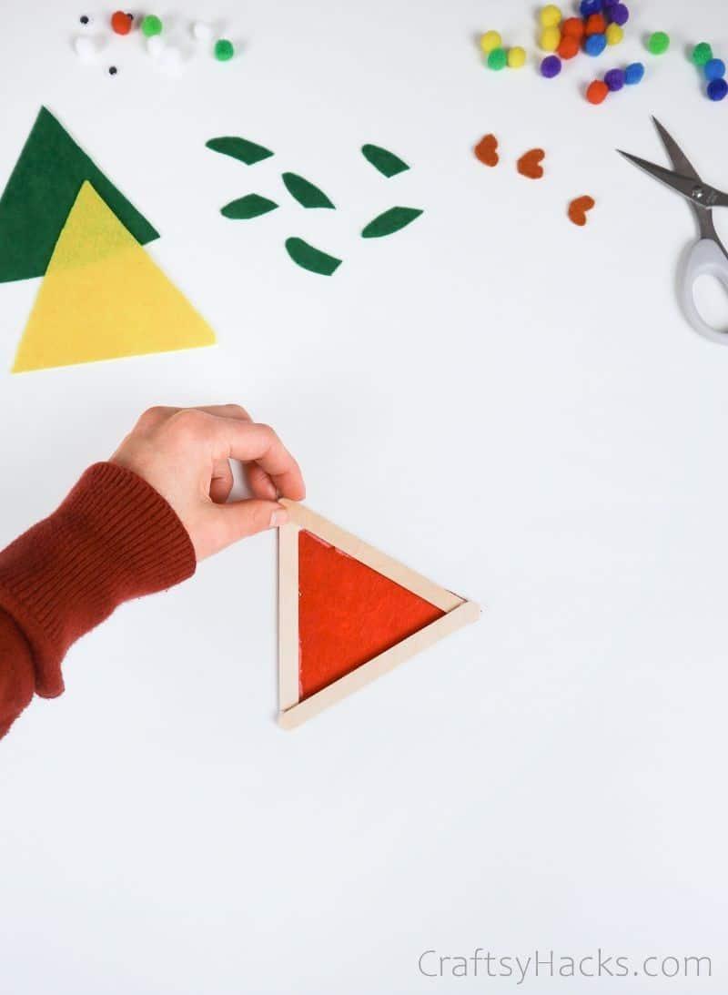 felt glued onto popsicle stick triangle