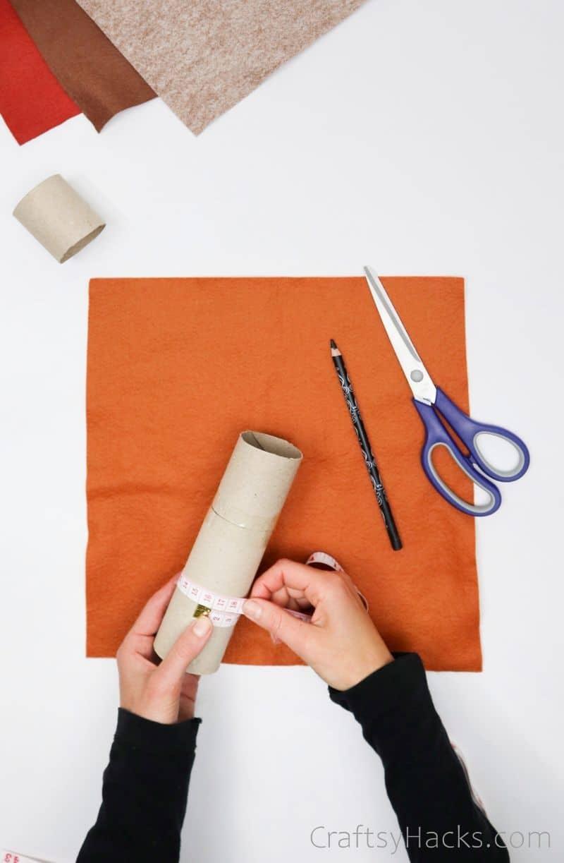 measuring around paper roll