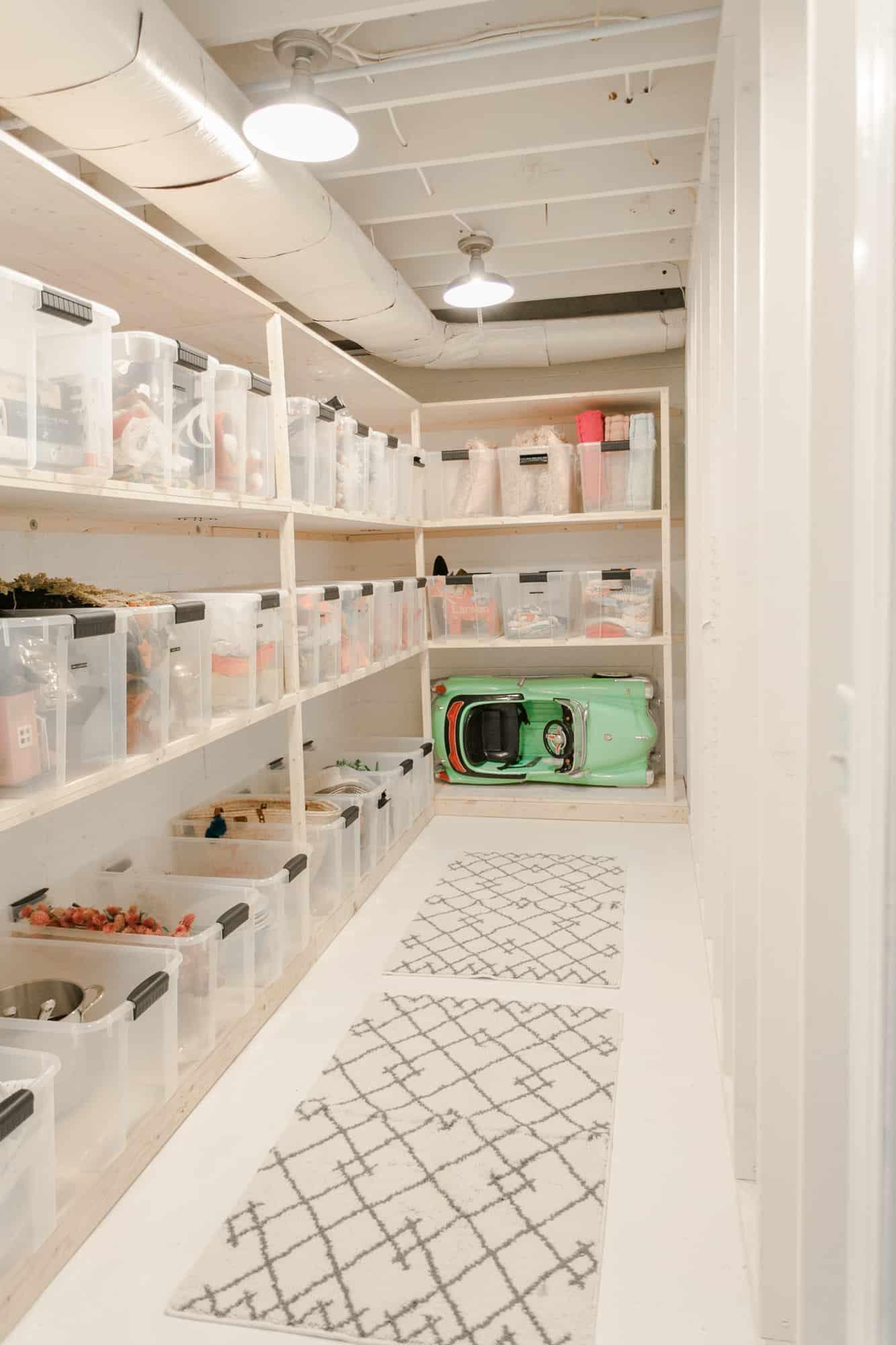 basement hallway with bins