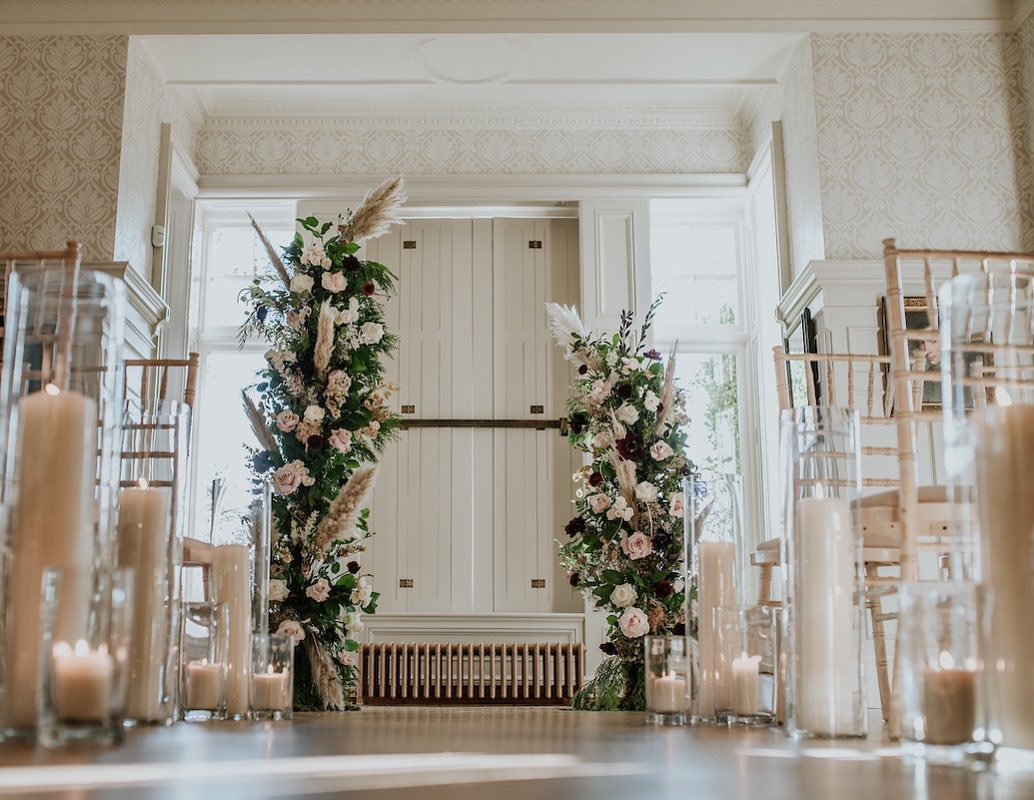 Floral Pillars and Burning Candles