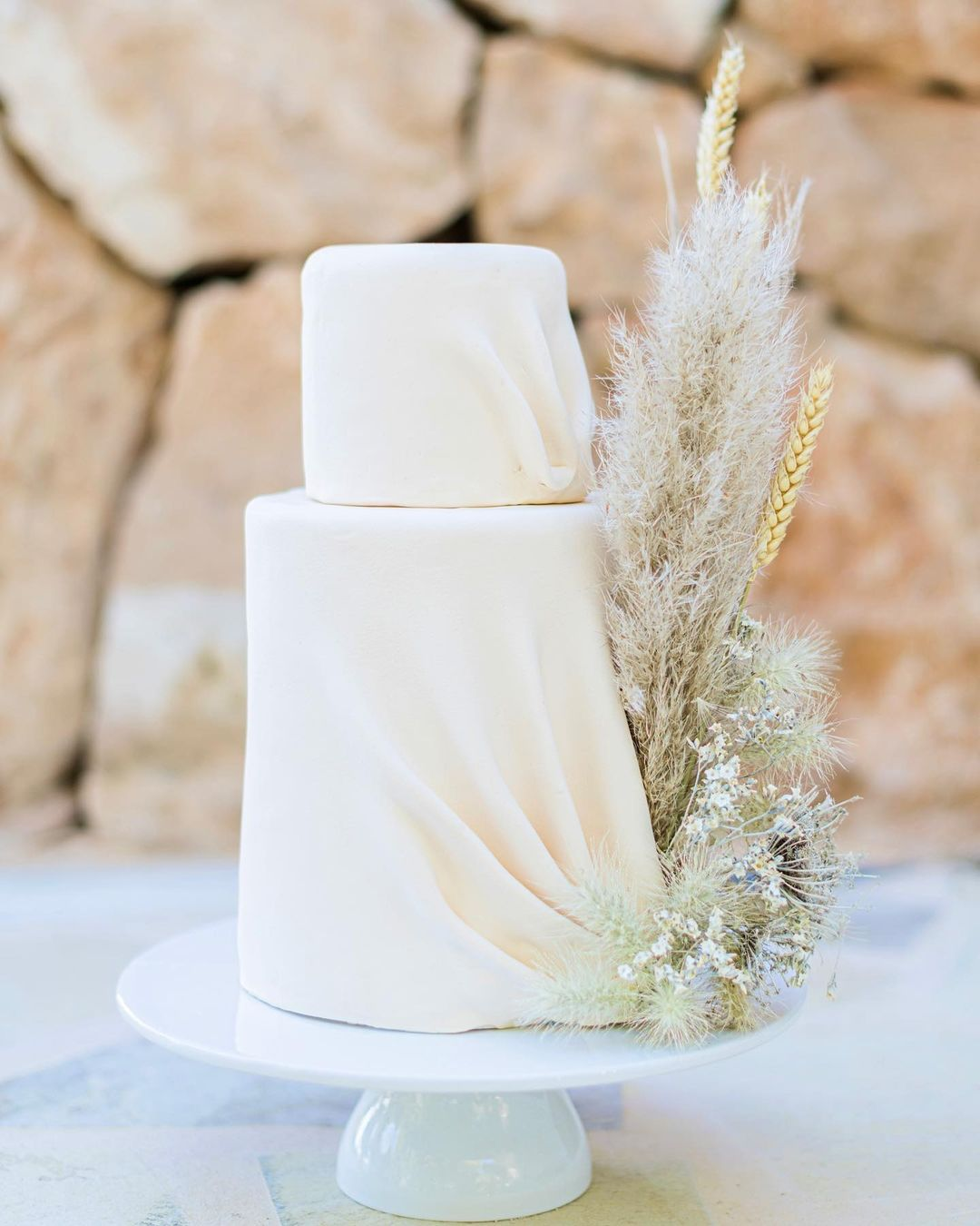 draped cake with grass