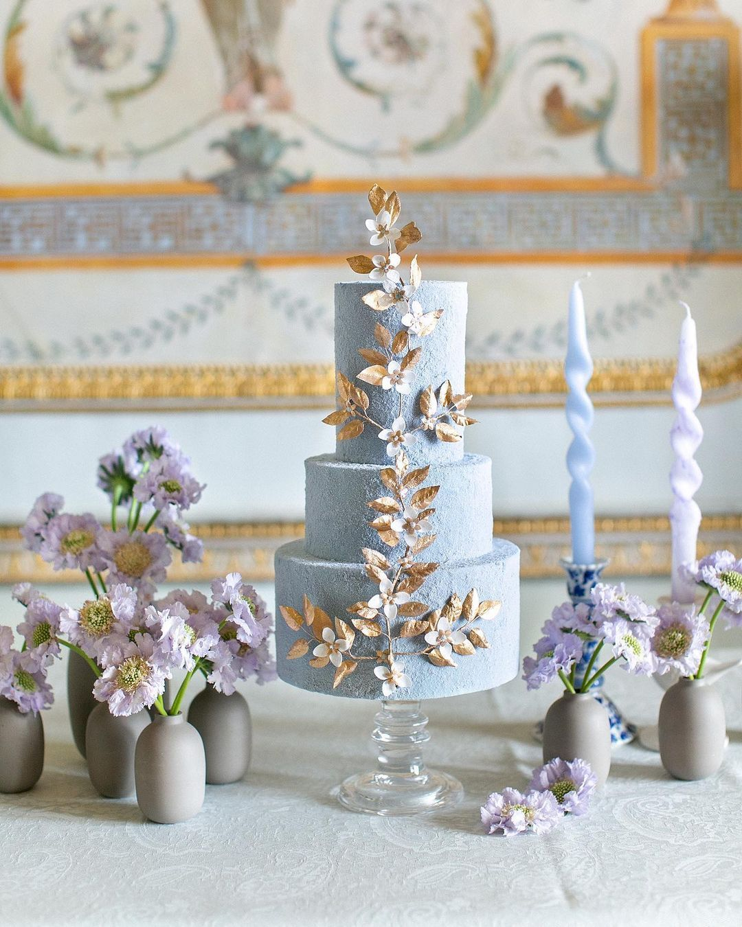 light blue cake with gold leaves