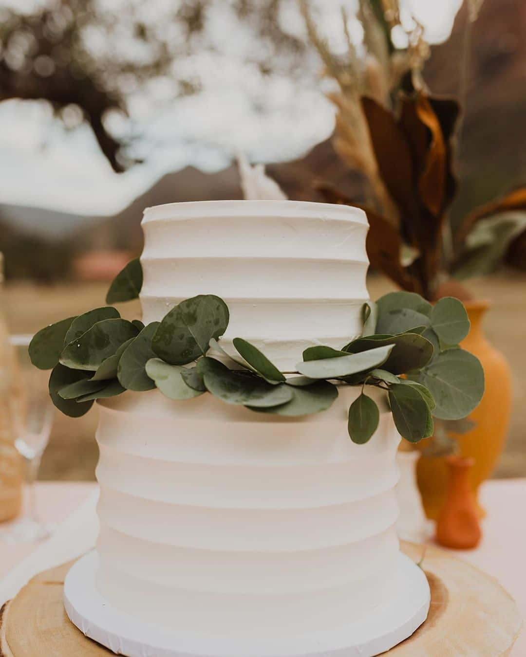elegant cake with green leaves
