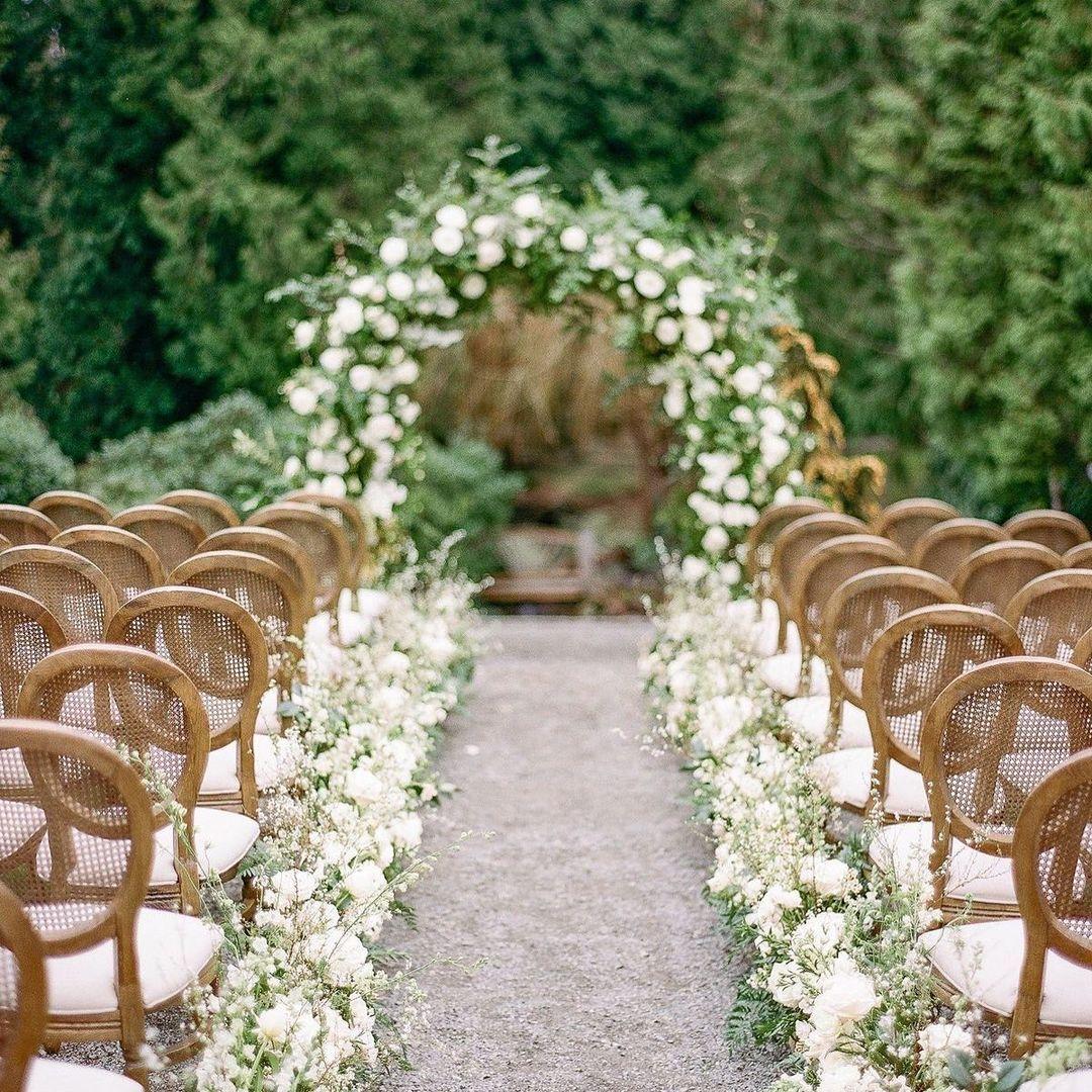 white roses in aisle