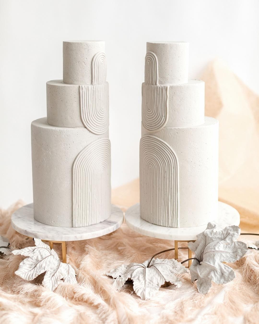 two cakes with white arches