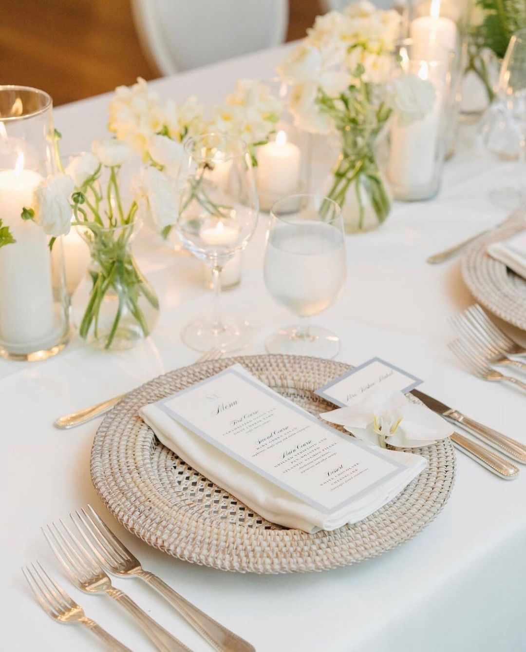 White Roses, White Candles, And Whicker Plates