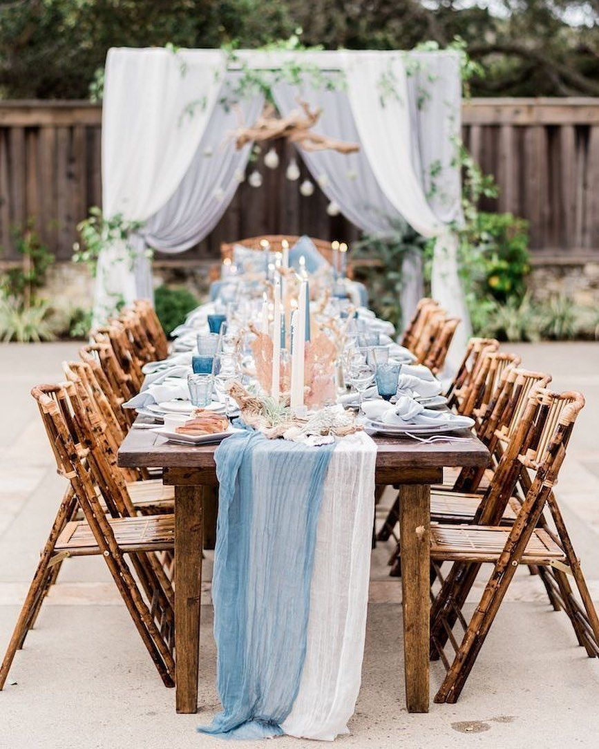 white and blue decor with wood table