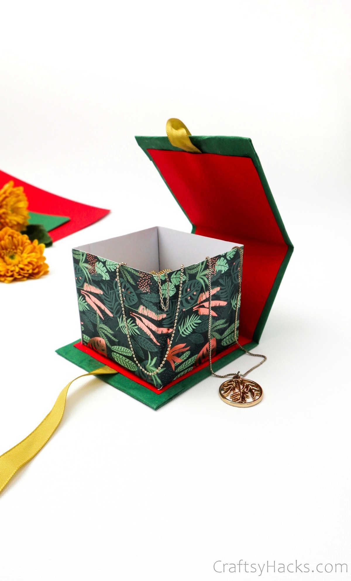 open gift box with jewelry