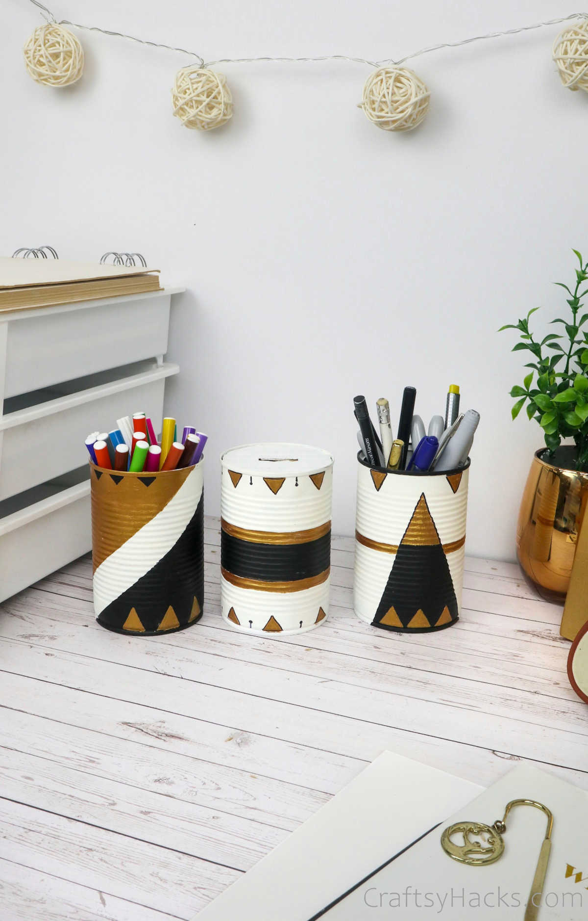 three upcycled tin cans