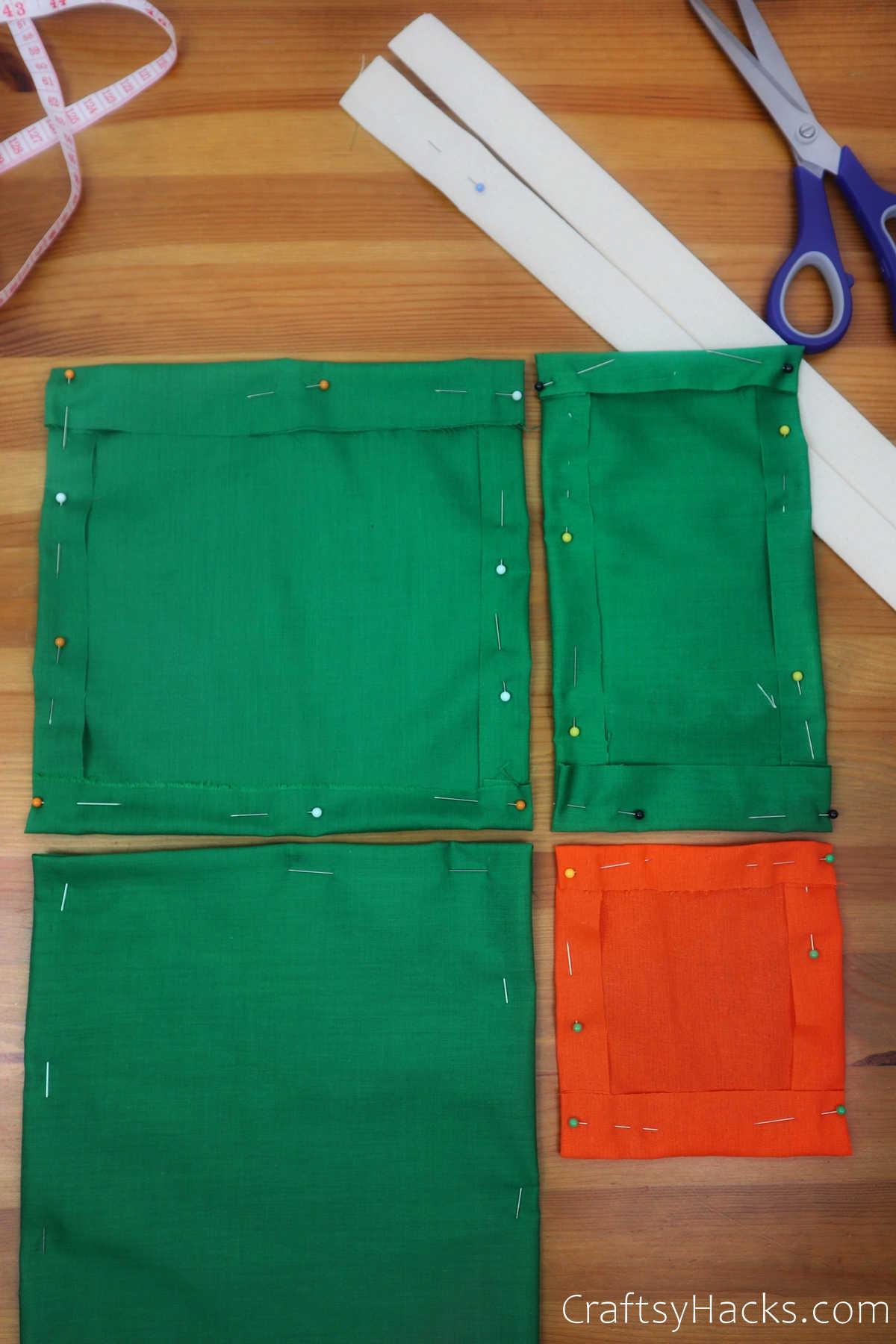 4 pinned fabric pockets