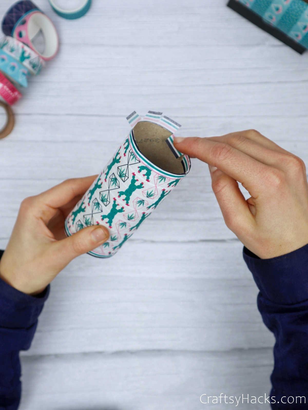 tucking washi tape inside paper roll