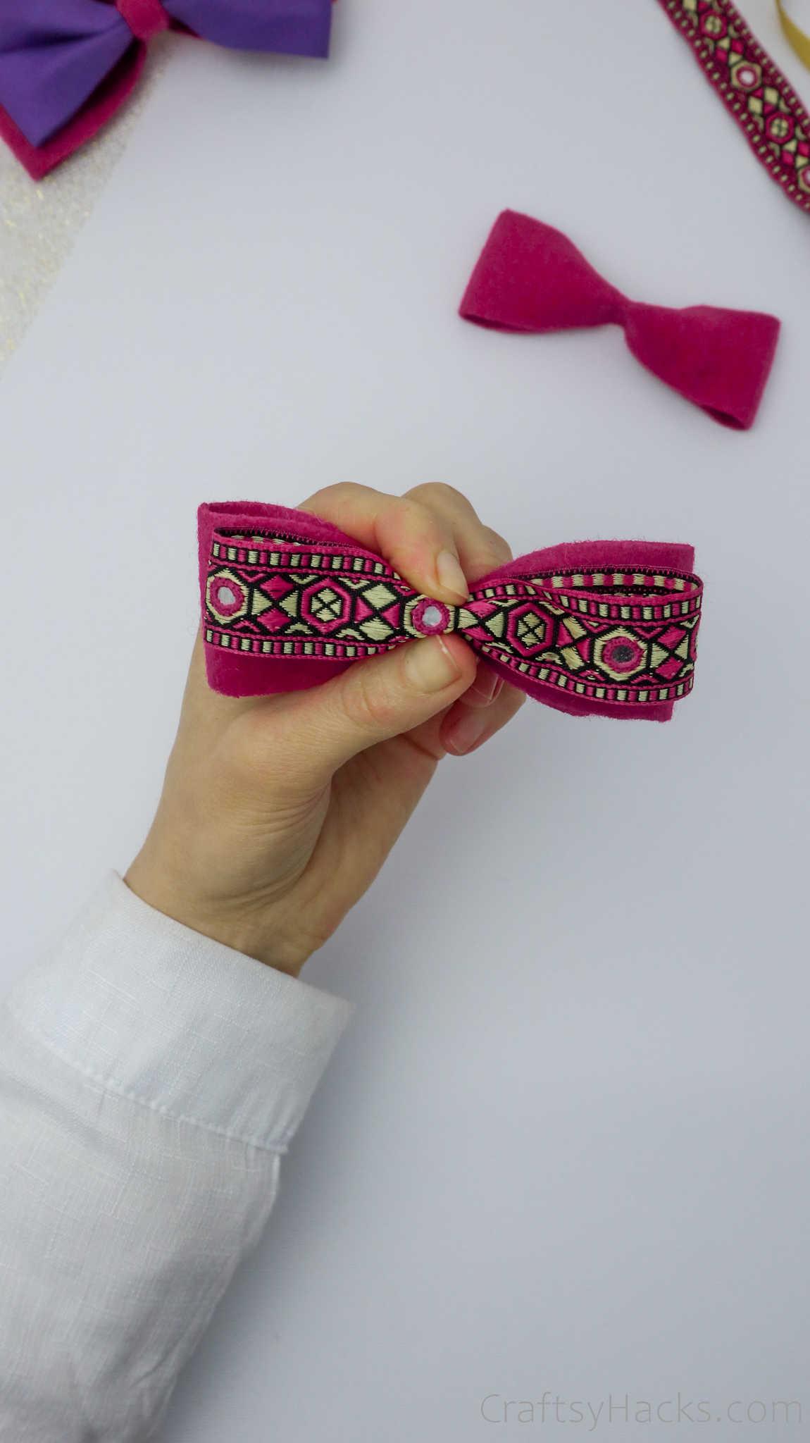 adding ribbon to bow