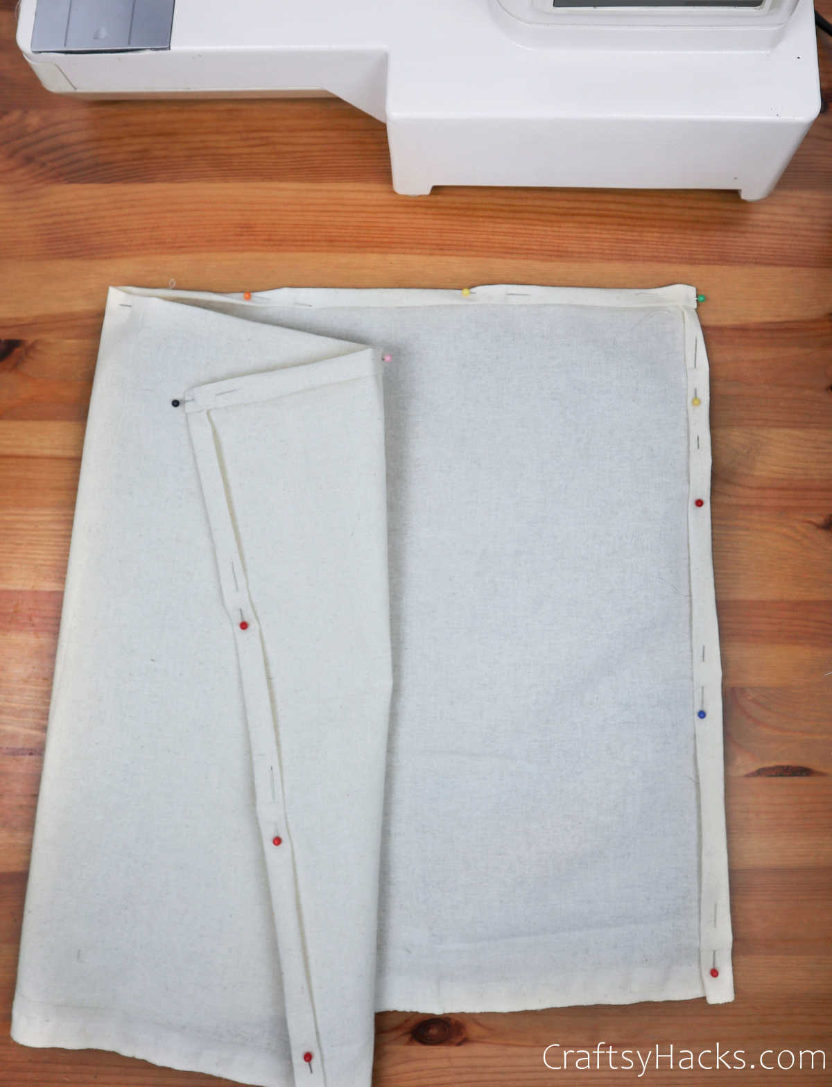 white fabric with pinned edges