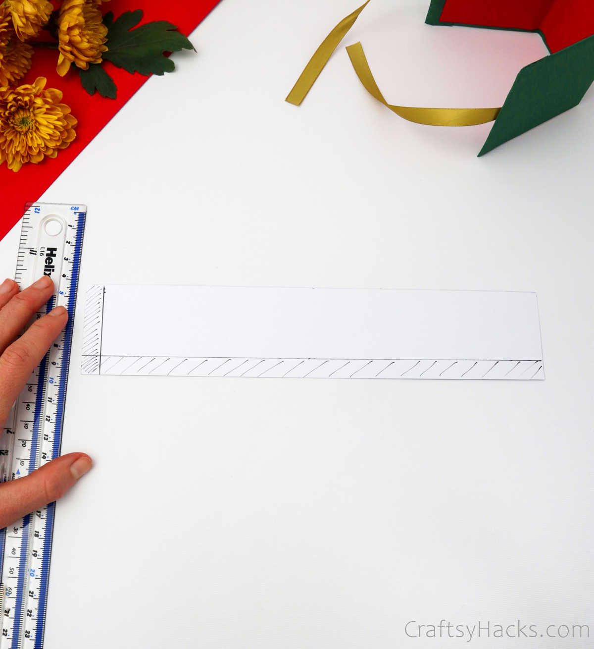 measuring paper with ruler
