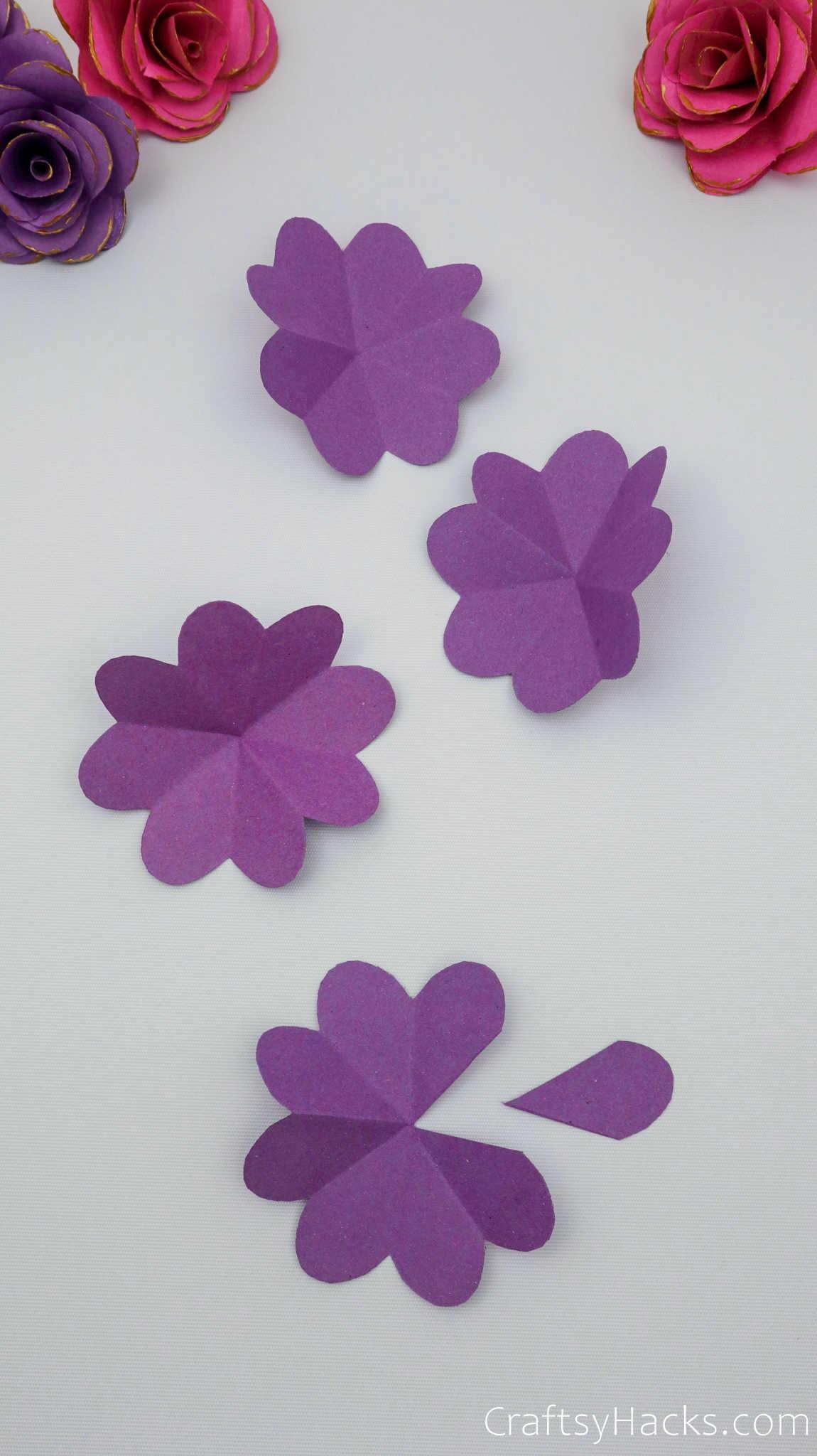 4 purple paper flowers